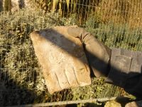 2. Holding carved stone